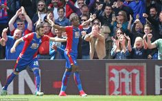 Wilfried Zaha (right) celebrates with the home fans after getting them off to the perfect start at Selhurst Park on Sunday