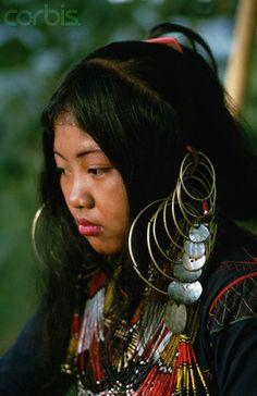 Philippines | An Ubo woman wears an embroidered dress, hoop earrings, and bead necklaces. Mindanao.  1970 | © Dean Conger/Corbis