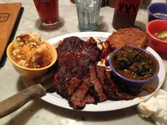 "Baby Blues BBQ in West Hollywood. On the menu look for 'Blue Devil' plate: brisket, Memphis-style ribs, baby back ribs, tri-tip and ""Baby Blue Bayou"" grilled bbq. Accompanied by corn bread, collard greens and mac and cheese."