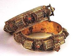 """From the Israel Museum, Jerusalem: Bracelets (gubur) to be worn by a woman after childbirth and for festive occasions; called """"tomb"""" bracelets because the box-like components look like tombs. From Sana'a, Yemen"""