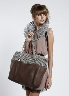 Italian company makes purses, jewelry and accessories out of recycled aluminum can pop-tops