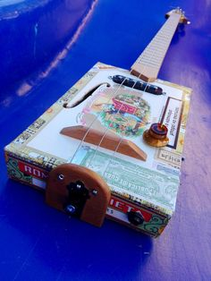 Excited to share the latest addition to my #etsy shop: Electric Cigar Box Guitar 3 string http://etsy.me/2HMbZwc #music #instrument #cigarboxguitar #electric #blues #egst  #retro #luthier