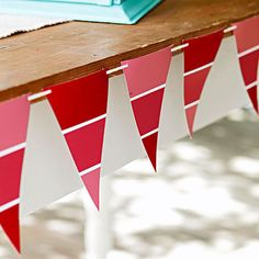 Cut paint-chip cards into triangles to make these flag-inspired pennants. More easy 4th of July party ideas: http://www.bhg.com/holidays/july-4th/crafts/easy-fourth-of-july-party-ideas/?socsrc=bhgpin061313paintflags=3