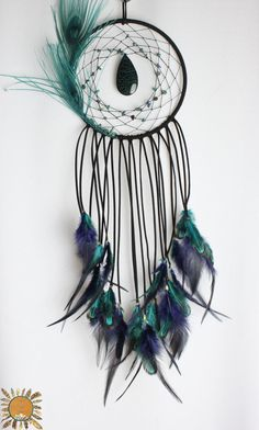 Black and Teal Dream Catcher with a Dragon Vein Agate, Chrysocolla, Peacock Feathers, and Colored Pheasant Feathers