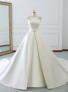 Satin Wedding Dresses White Satin Cap Sleeve Backless Wedding Dress With Pearls - Description Silhouette:ball gown Hemline:floor length Neckline:bateau Fabric:satin Shown Color:white Sleeve Style:cap sleeve Back Style:lace up Embellishment:pearls Dream Wedding Dresses, Bridal Dresses, Satin Wedding Gowns, Lace Dresses, Floral Dresses, Wedding Dress With Pearls, Dress Lace, Custom Dresses, White Dress