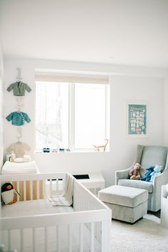 A modern Brooklyn nursery // OMG this could be MY nursery: hand knit sweaters on the wall and a Penguin plush in the crib!
