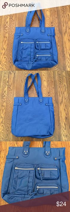 "🎉JUST IN🎉 Royal blue tote handbag purse Soft faux/vegan leather tote handbag in royal blue from Lane Bryant in like new condition. Three zip pockets on the front; one large phone sized pocket & two smaller ones sized just right for business/credit cards, etc. Main compartment has a magnetic snap closure with a single zippered pocket inside. 14"" tall by 14"" wide by 4"" deep. 🚫No holds 🚫No Lowball Offers 🚫No Trades ✅Please submit reasonable offers via the offer button or 🎁 bundle & save…"