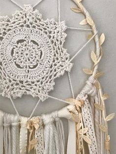 This boho-inspired dream catcher is a lovely addition to a beautiful night's sleep. You can customize it and add the details you want to make it the perfect dream catcher for your home. It also makes the perfect gift for a baby shower, graduation, new baby, bridal shower or house warming. Sweet dreams. Custom Bohemian
