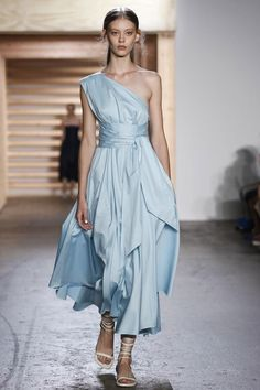 How To Wear A Belt Like A Fashion Girl   The Zoe Report Tibi-This gown's thich sash belt reins in the abundance of fabric without distracting from the beautiful design.