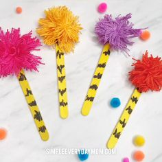 Kids will have fun making these easy truffula trees at home or in the classroom. Theyre made from popsicle sticks and embroidery floss and can also be used as bookmarks. Theyre a great art project for read across America day! Craft Projects For Kids, Crafts For Kids To Make, Kids Crafts, Art Projects, Craft Kids, Popsicle Stick Crafts For Kids, Craft Stick Crafts, Popsicle Sticks, Dr Seuss Activities