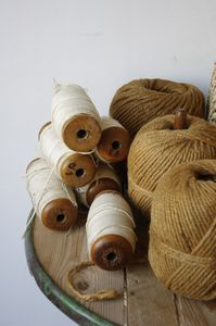 Spools of brown and white twine