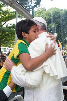 "Pope Francis beamed at the small child in the Brazilian national soccer team jersey and told him, ""I am going to pray for you, but I ask you to pray for me."" He wiped tears from his eyes as he embraced de Brito and told him, ""As of today, your vocation is set."""