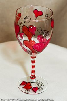 Hand Painted Heart Wine Glasses. Hand painted and Sold as a set of 2. Featuring three shades of red and pink hearts. These glasses have been painted