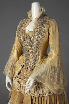 Yellow silk dress trimmed with steel beads and fringe, American, ca. 1880, KSUM 1983.1.156.