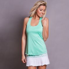 Racer-back TENNIS top with slight a-line shape for a flattering fit, green piping under bust. Soft microfiber and Supplex fabric. Proudly made in the USA! BUY NOW http://www.denisecronwall.com/#!product/prd13/2521065441/calypso-racer-back-top