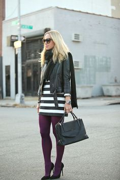 colored tights done right.  simple stripes in black and white and a leather jacket