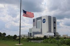 """NASA Honors Orlando Victims The American flag flies at half staff at NASA's Kennedy Space Center in Florida, with the iconic Vehicle Assembly Building in the background. On Sunday, June 12, President Barack Obama ordered U.S. flags flown at half staff """"as a mark of respect for the victims of the act of hatred and terror"""" at the Pulse nightclub in Orlando.  June 13, 2016"""