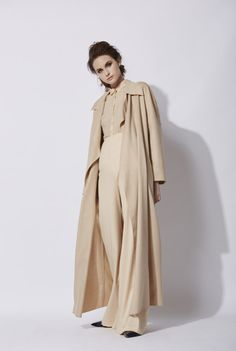 Nose Coat in beige: Long wool coat made of 100% baby camel. This model has no lining and a collar with wide lapels. The coat has pockets on the sides, and the finishings of the coat uncapped, with the outline stitching visible. This model is available in green and in beige.  Made in Barcelona. Cortana AW 2016 collection.