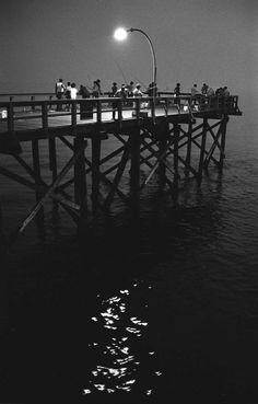Coney Island Pier, Night Fishing, 1973. (Harold Feinstein)