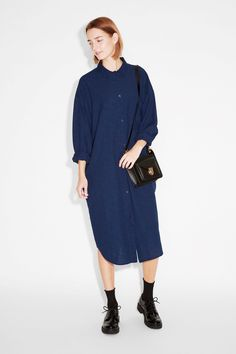 A Tokyo-ready denim dress with a popped lapel neckline, button front and half sleeves.