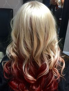 Platinum blonde with red underneath. Done by Angel Ross