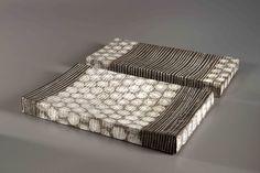 Petra Bittl,two flat objects, belonging together, black stoneware, porcelain