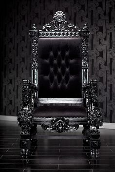 4061 BLACK LACQUER BAROQUE THRONE CHAIR  Be the king or queen or your house in this magnificent throne chair. Reminiscent of the thrones royalty used to sit in during the Baroque period and hand-carved out of the highest quality imported wood, this large chair exudes grandeur and sophistication. Upholstered in the finest black velvet and finished with beautiful chrome studs, this chair is the perfect rock star addition to any home.  It can be customized as you please!
