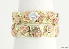 """Vintage engagement & wedding ring set. Unique design has vivid 14k rose & yellow gold. The wide bands have a polished base with rose gold flowers at the top intertwined with yellow gold vines. The matching engagement ring features a high quality .30ct genuine European cut VS1 Clarity G Color diamond in a white gold head. Both bands have a 14k gold purity stamp & are great for engraving & personalization.  9.9 grams. Together face measures 7/16"""" (11.5mm) tall & the table height is 9/32""""…"""