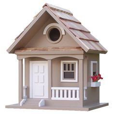 "BIRD HOUSE – Offer feathered friends a cozy abode with this beautifully crafted birdhouse, showcasing a pine-shingled roof and weather-resistant finish. Construction Material: Exterior grade ply-board, kiln-dried hardwoods, pine and polyresin, and Western red cedar shingles Color: Cafe au lait Features:  Removable back walls for easy cleaning and real shingled roofVentilation and drainage1.25"" Hole openings designed to accommodate common birds"