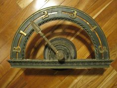 Antique Elevator Floor Indicator by CowbellAntiques.  Have always wanted one to hang by staircase or above doorway.