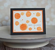 handmade card: Tuesday Ideas: Watercolor Halloween ...  cheerful watercolor circles ... pumpkin face resist ... formal framed look in orange and black ... great fun!