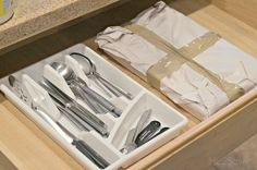 Wrap your silverware trays in paper and tape or plastic wrap