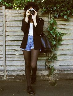Jacket, shirt + shorts, hat, tights, Doc Martens.
