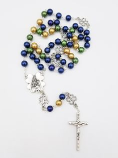 Patron Saint The Crucifix measures 5//8 x 1//4 Silver Plate Rosary Bracelet features 6mm Emerald Fire Polished beads The charm features a O//L of Hope medal