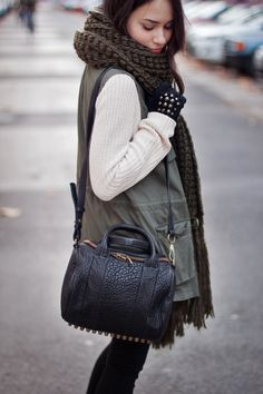 Nisi is wearing an oversized scarf, a military vest and the studded alexander wang rookie bag - teetharejade.com