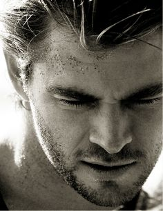 chris hemsworth. let me lic....er um, i mean, wipe that sand from your face