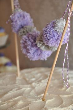 Lavender, Gray, and Silver Yarn Pom Pom Cake Bunting. $16.95, via Etsy.