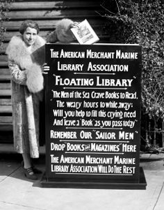 "The Drive for Books -Mrs. Coolidge dropped the first book into the big box that starts the drive by The American Merchant Marine Library Association for ""floating library"" for our ""sailor men."" - January 7, 1929."