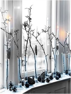 Winter decor for a window sill.. I would do this with half as many twigs.