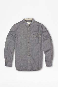 "<ul> <li> Cotton shirt</li> <li> Long sleeves with buttoned cuffs</li> <li> Button-down collar</li> <li> Full button placket with exposed 3/4 length overlay</li> <li> Tight geometric pattern</li> <li> UK size M back length is 78cm</li> </ul>  <strong>Our model is 6ft 2"" and is wearing a size M.</strong>"