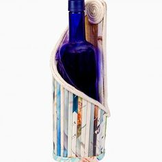 Single wine bottle holder/magazine holder  This is a wine bottle holder, made from recycled magazines. It can also be used as a magazine holder.  www.peek.org.za
