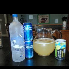 Summer Beer - 1 large can frozen limeade concentrate, 1 can water, 1 can vodka, 2 light beers