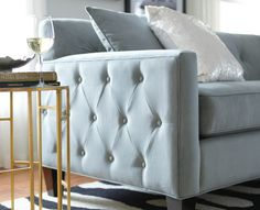 Pretty in blue and tufted to perfect. These tufts on the arms really give this sofa character. HomeDecorators.com #livingroom #seating