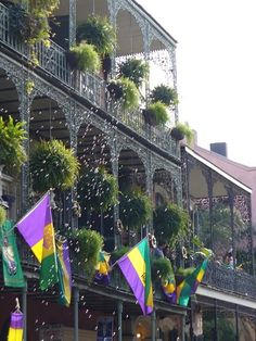 New Orleans, French Quarter Balconies decorated with Mardi Gras flags