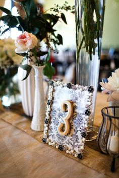 Creative Wedding Table Number Ideas, beach wedding table number www.loveitsomuch.com