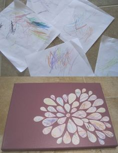 Recycle kids' art by cutting up and decoupaging on painted canvas.