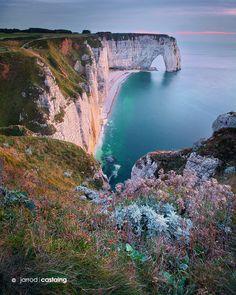Cliffs of Etretat by Jarrod Castaing.  Sunset at the white cliffs of Etretat on the coast of Normandy, France.