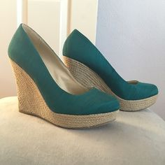 Wedges Teal wedges. Covered toe. Has a light tan colored wedge. Never worn. Shoes Wedges