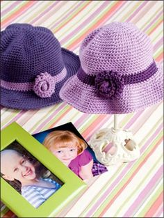 Not a free pattern.  Inspiration only  I LOVE what a change you can make by adding some simple appliques! Find a basic, plain, free pattern for a hat and blanket, then jazz them up with a couple, easy, flower and leaf appliques!  This pattern is available for purchase if you follow the link.