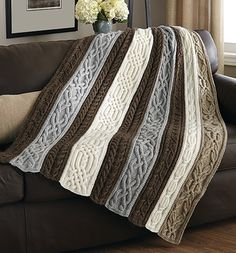 Panels of beautiful, rich cables are knit separately, then sewn together to create this stunning throw.